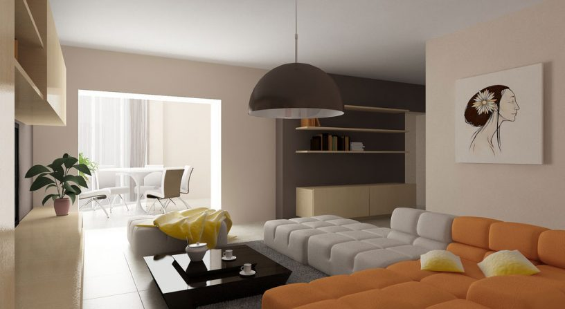 Warm Lving Room with Orange White Couch and Chandelier