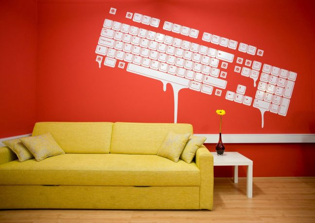 Yellow Couch with Mural Wallpaper Paint