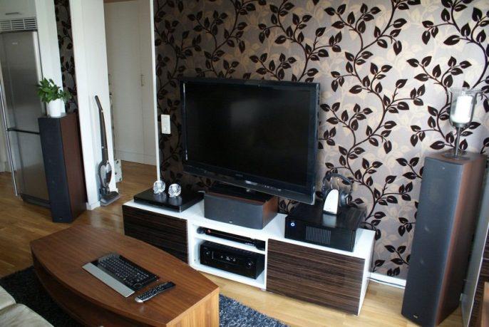 Modern LCD TV Room Design with Leaf Wallpaper