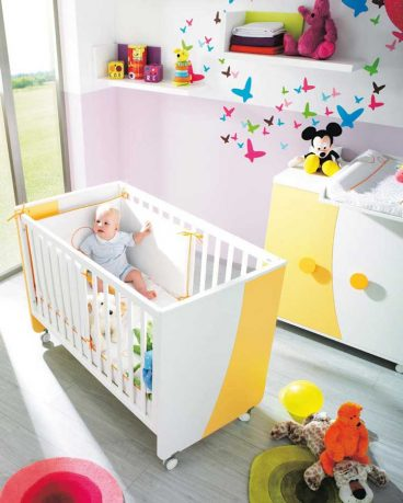 White and Yellow Nursery Crib