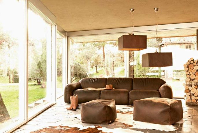 Brown Couch Country Living Room with Cowhide Rug Decor