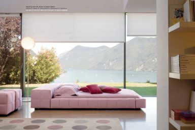 Cozy Pink Bedroom with Glass Wall and Lake View