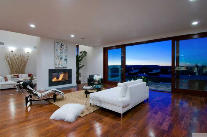 Living Room with White Sofas and Outdoor View