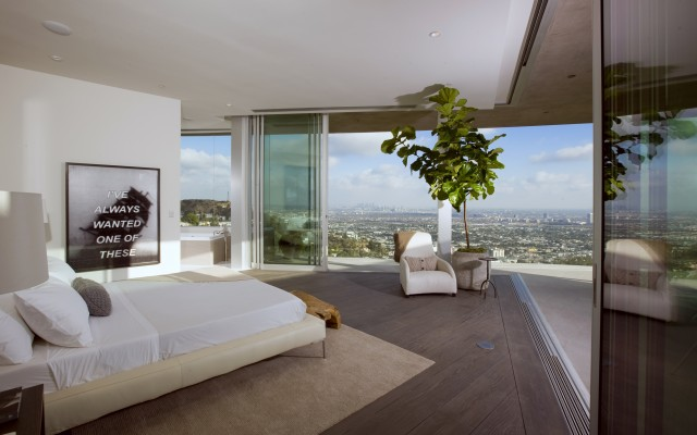 Modern Bedroom with Large Sliding Door and View