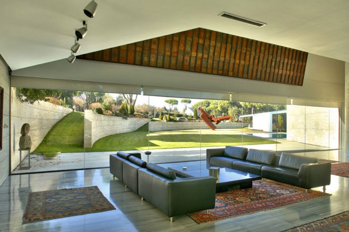 The Living Room Space Design with Dark Green Leather Sofa