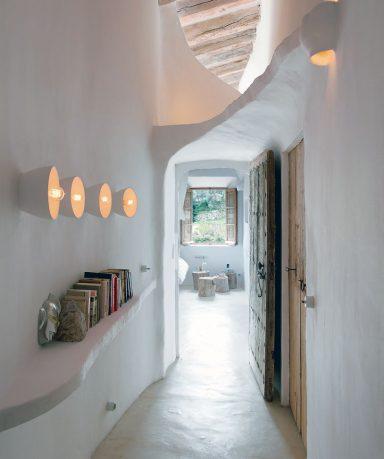 Unique Cave Home Hallway with Old Door Design