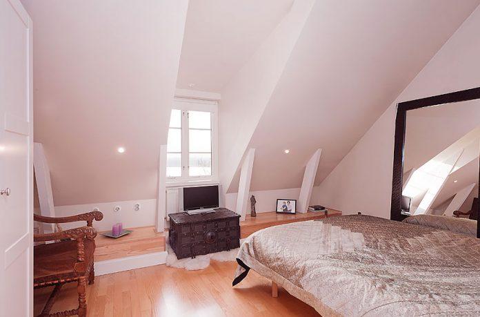 Bright Attic Bedroom Design with Wooden Floor