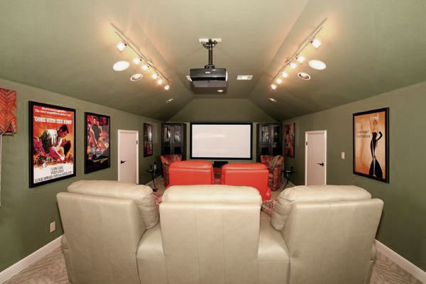 Captivating Movie Room with Green Wall Design