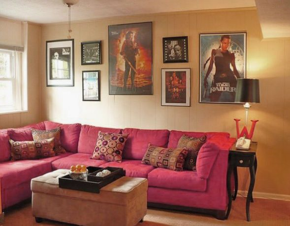 Small Movie Room Design with Pink Sofa and Movie Posters