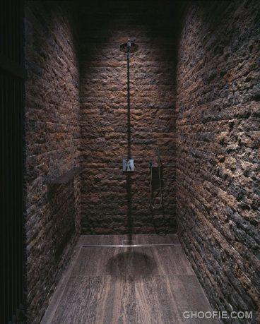 Stacked Stone Wall Bathroom Design