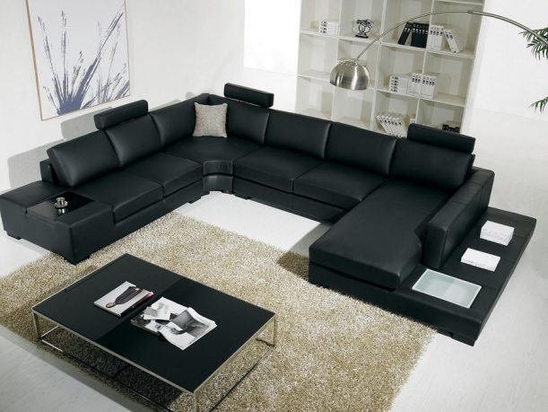 Black and white sectional sofa with table