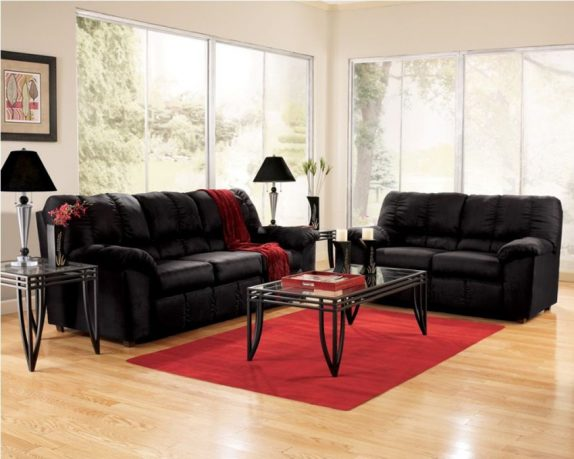Black leather sofas with small table