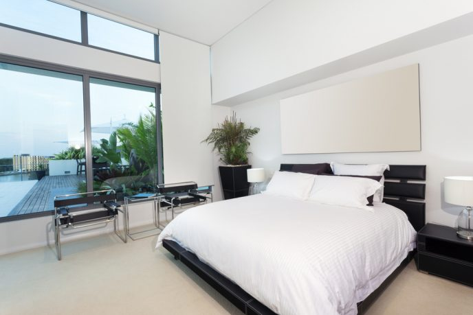 California master bedroom with white sheets