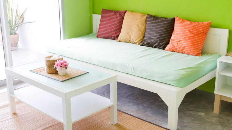 Colorful green room with couch