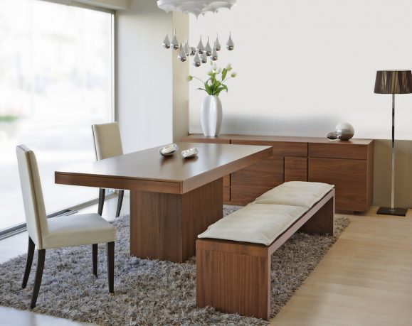 Dining room with bench seating and rug