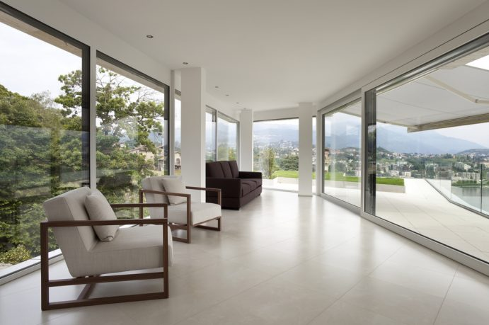 Glass house living room with view