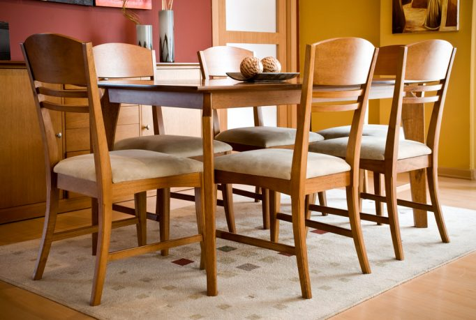 Traditional dining room with six wood chairs