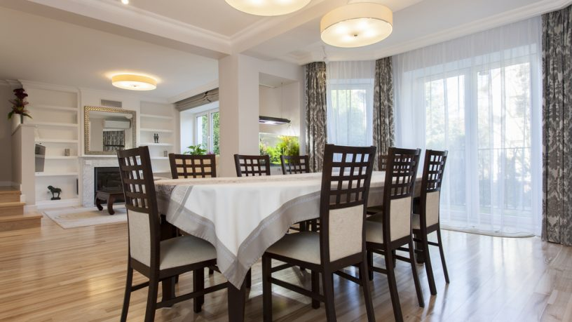 Unique dining room with circle lamps and wood chairs