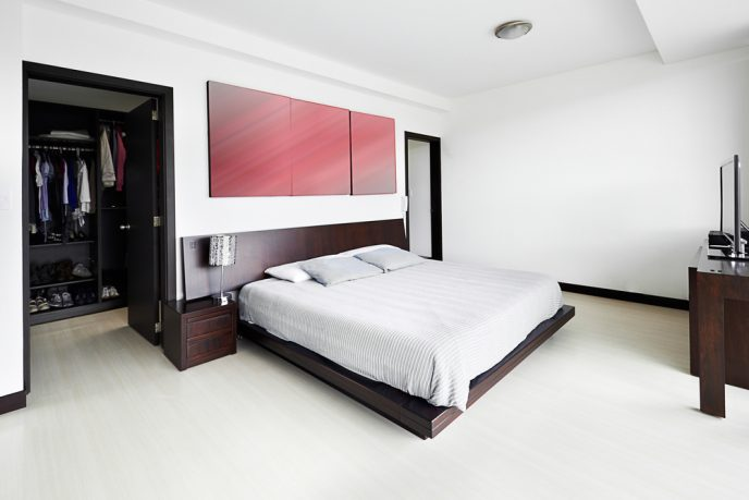 White bedroom with wood accents