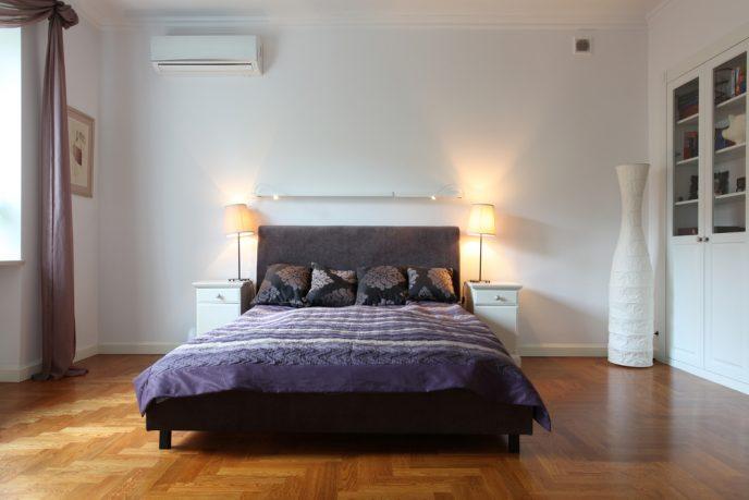 Wood floor bedroom with natural light