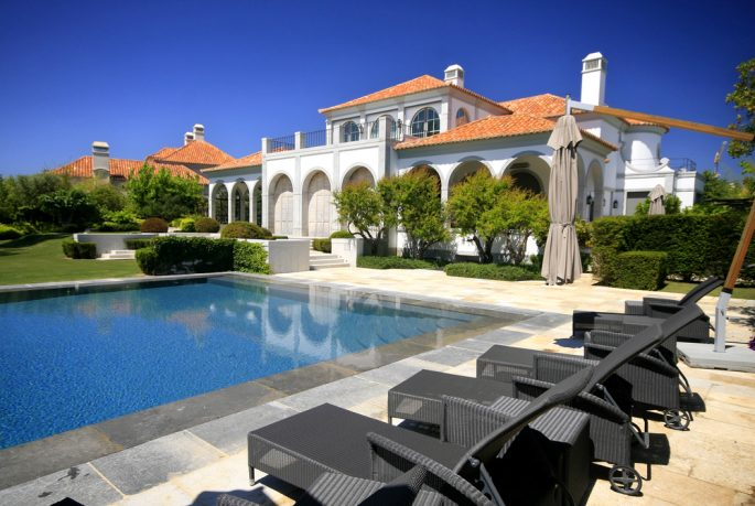 Luxurious pool with chairs