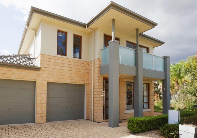 Stucco and brick modern home