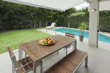 Backyard dining area pool