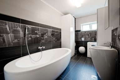 Modern bathroom with mural and white tub
