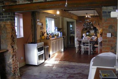 Rustic kitchen with brick walls
